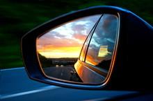 Setting Sun In Car Wing Mirror