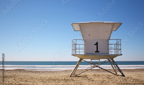 Classic California life guard station on a bright blue day