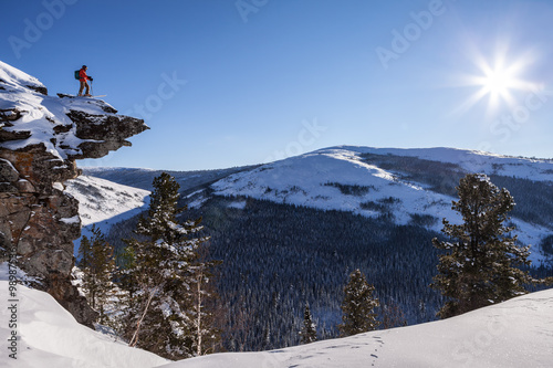 Extreme skier on the high rock Canvas Print