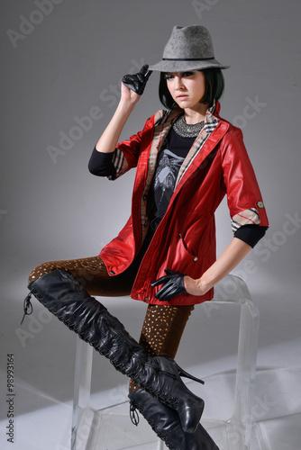 Deurstickers Stierenvechten attractive fashionable girl sitting cube in studio