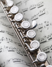 Flute And Music Sheet