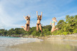 Summer holidays and vacation - girls jumping on the beach.Tropical vacation .Thailand . Phuket . Freedom beach.
