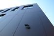 Building with camera surveillance
