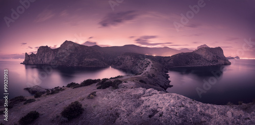 Fotobehang Aubergine Beautiful night landscape with mountains, sea and starry sky