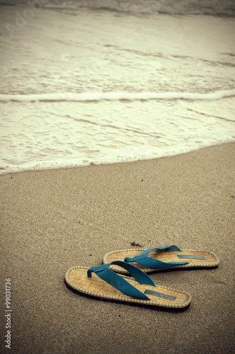Photo  Vintage Looking Sepia Sandals and Ocean Water