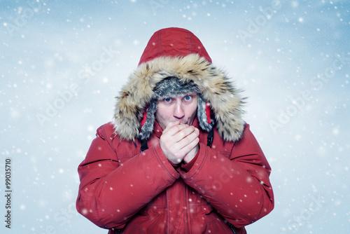 Fotografia, Obraz  Man in winter clothes warming hands, cold, snow, blizzard