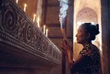 Burmese woman praying in temple
