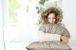 Leinwandbild Motiv Woman warmly clothed in a cold home