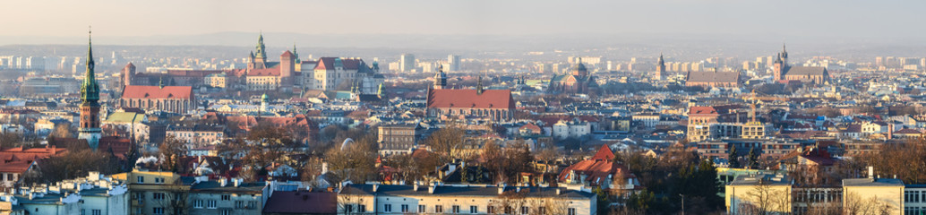 Fototapeta Kraków Panoramic view of Royal Wawel Castle in Krakow and St. Mary's Basilica, view from Krakus Mound