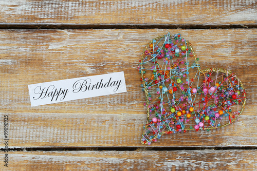 Happy Birthday Card With Heart Made Of Colorful Beads On Rustic Wooden Surface