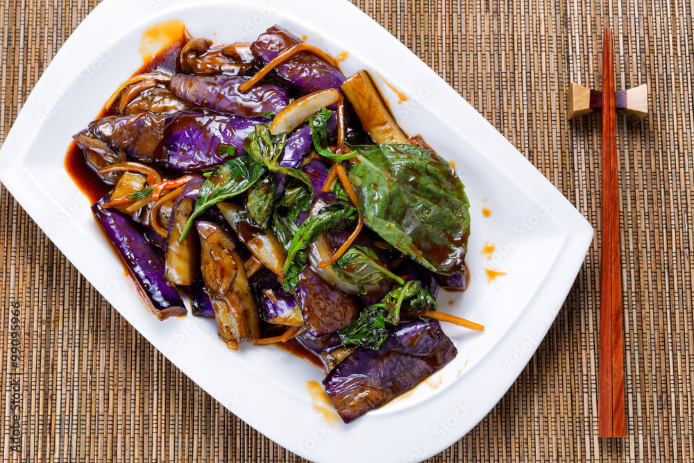 Photo  Prepared juicy eggplant and basil herb dish