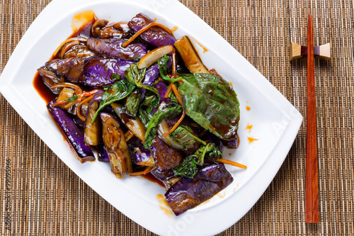 Photo  Prepared juicy eggplant and basil herb dish