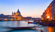 Basilica Santa Maria among the Grand Canal and traditional gondolas in Venice city,