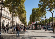 The Champs-Elysees The Most Famous Avenue Of Paris And Is Full Of Stores, Cafes And Restaurants.  Paris France