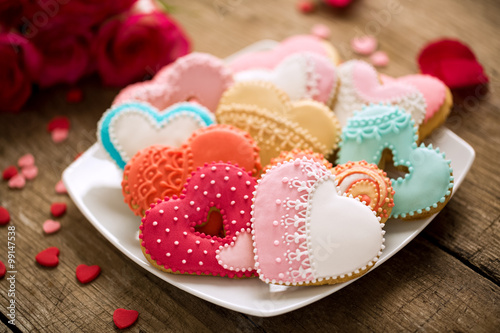 Photo  Different colored festive cookies hearts