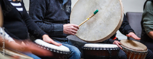 Fotografie, Obraz  Group of people playing on drums - therapy by music