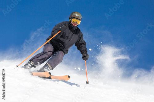 Slika na platnu Male skier skiing at ski resort
