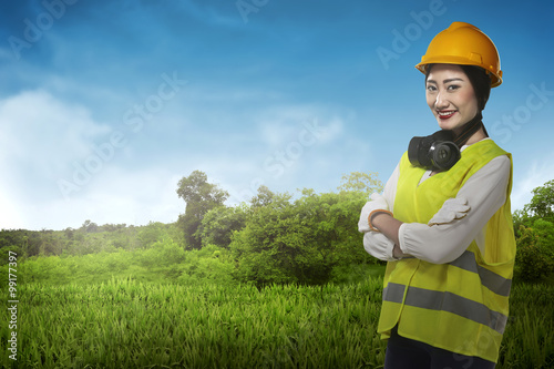 de4b9637969 Asian business woman wearing yellow helmet smile - Buy this stock ...