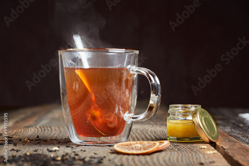 Stickers pour porte The Steaming tea and honey on a wooden table
