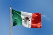 Mexican Flag Against Blue Sky