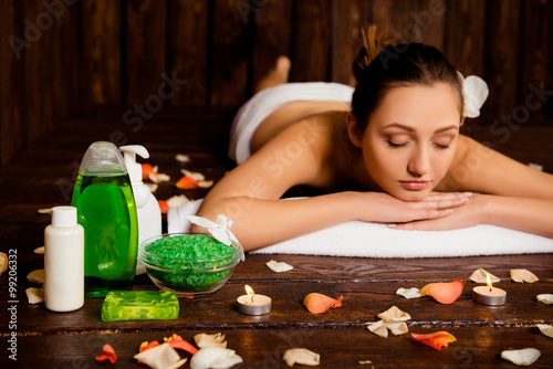 Fototapety, obrazy: Calm pretty young woman laying in spa salon with closed eyes and