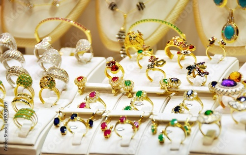 Golded rings in a shop - 99209139