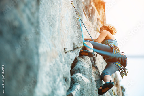 Fotografie, Obraz  Rock climbing on vertical flat wall - Stock image