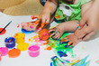 children's feet and hands in paint.