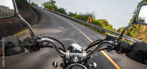 Motorcycle on the empty asphalt road Wallpaper Mural