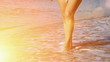 A young woman with bare feet walking on the sea beach in slow motion, Slow Motion Video clip