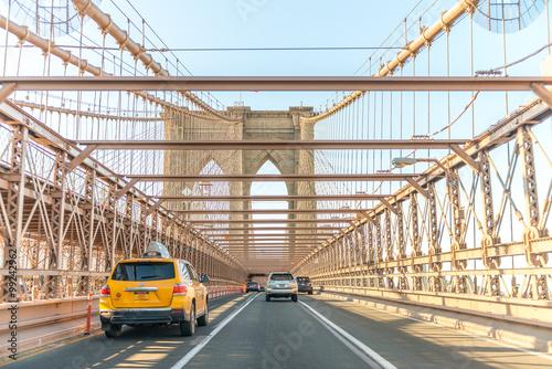 Brooklyn Bridge road and city skyline, New York City