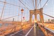 Walking along Brooklyn Bridge at dusk, New York City