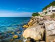 Beautiful blue sky, sea and rocks at Bang Saen Thailand.