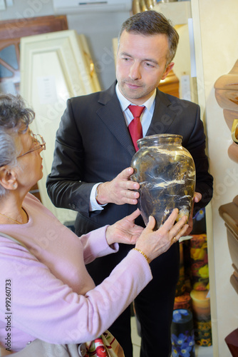 Funeral director with widow choosing urn Canvas