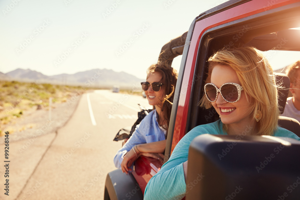 Fototapety, obrazy: Female Friends On Road Trip In Back Of Convertible Car