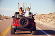 canvas print picture - Rear View Of Friends On Road Trip Driving In Convertible Car