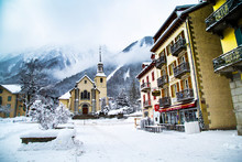 Church In Chamonix Town, France, French Alps, Part Of Street  And Mountains