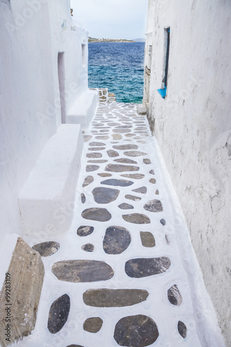 Traditional whitewashed alley of Mykonos with seaview, Greece Canvas Print