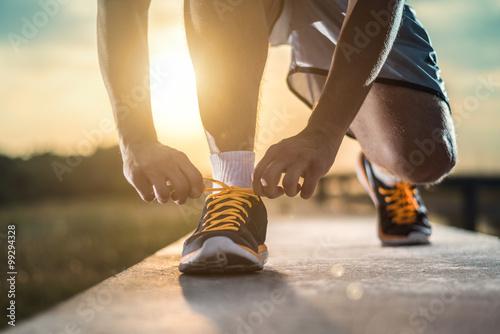 Poster Jogging Close up shot of runner's shoes