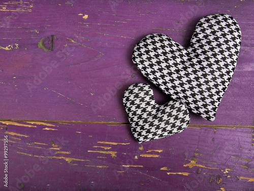 Photo  houndstooth hearts on a pinkbackground