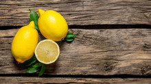 Lemons With Leaves. On Wooden ...