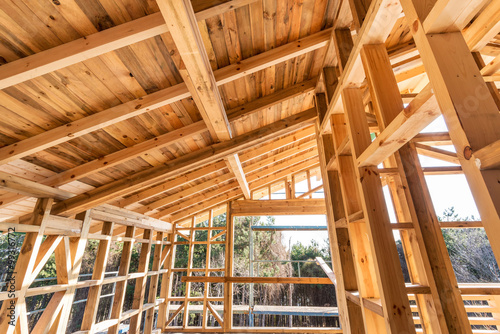 Wooden frame of a new house under construction Wallpaper Mural
