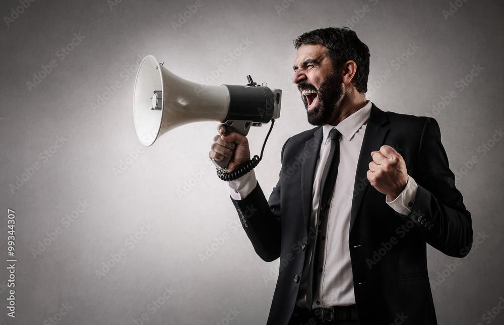 Fototapeta Fierce employee with a megaphone