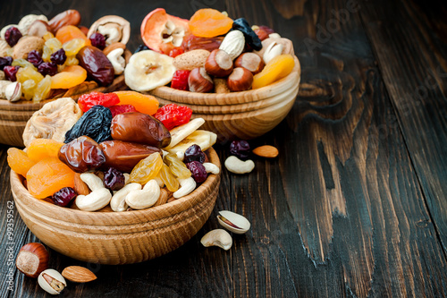 Mix of dried fruits and nuts on dark wood background with copy space Wallpaper Mural