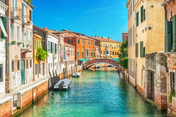 Fototapeta na wymiar Narrow canal in Venice, Italy.