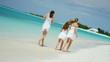 happy healthy young female Caucasian children beach tropical ocean casual living