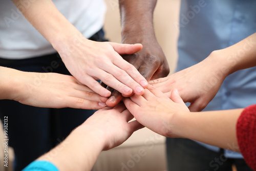 Fototapety, obrazy: White caucasian and black afro american hands holding together, friendship concept