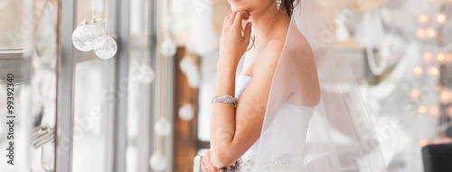 Stampa su Tela valentine's day, bridal, wedding, christmas, x-mas, winter, happiness concept - bride looking at window