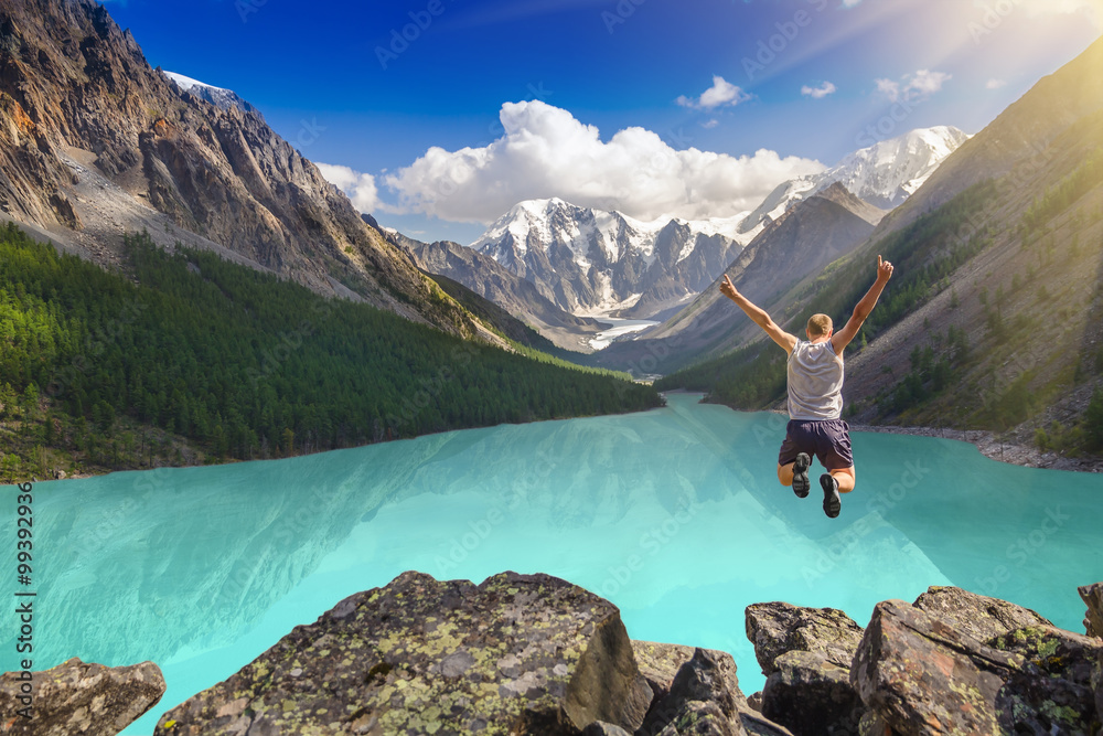 Fototapety, obrazy: Beautiful mountain landscape with lake and jumping man.  Extreme sports concept.