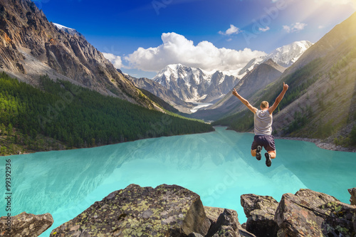 Fotografie, Obraz  Beautiful mountain landscape with lake and jumping man